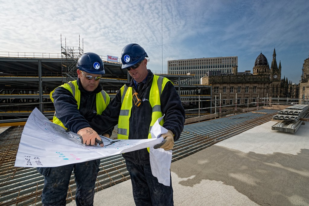 Project managers discuss an M&E Contract