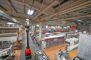 Wide shot of Mitton engineer working on lighting in B&Q store