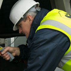 A Mitton engineer calibrating an aircon system