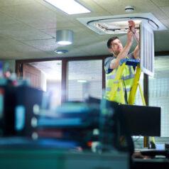 Engineer adjusting air conditioning